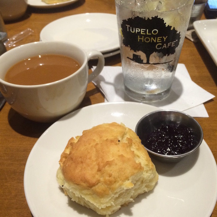 Brunch at Tupelo Honey starts with homemade biscuits & blueberry jam!
