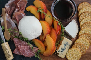 cheese board with peaches